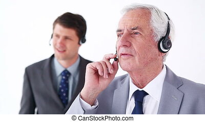 Serious businessmen using headsets