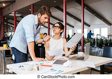 Serious businesspeople discussing business plan in office