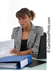 Serious businesswoman at her desk