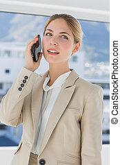 Serious businesswoman having a call