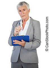 Serious businesswoman holding her clipboard