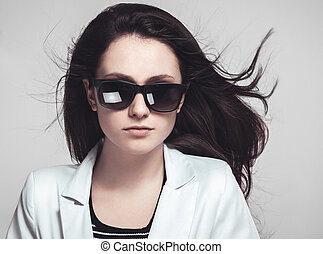 businesswoman looking through glasses