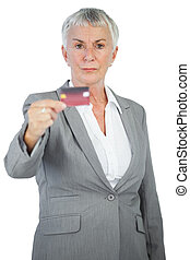 Serious businesswoman showing her credit card