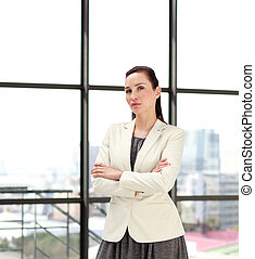 Serious businesswoman standing in an office
