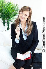 Serious businesswoman taking notes