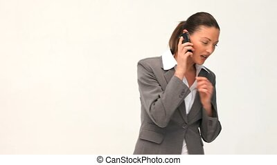 Serious businesswoman talking on the phone against a white...