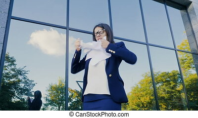 Serious businesswoman tearing contract in pieces. Angry furious female office worker throwing crumpled paper, having nervous breakdown at work, screaming in anger, stress management.