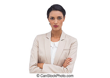 Serious businesswoman with arms crossed