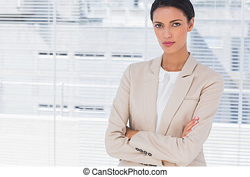 Serious businesswoman with arms folded