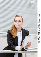 Serious Businesswoman With Digital Tablet