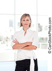 Serious businesswoman with folded arms
