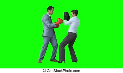 Serious colleagues in slow motion boxing