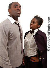 """This is an image of man and a woman striking a serious pose look. This image can be used to represent """"Business competiton"""", """"Battle of the sexes"""" etc.."""