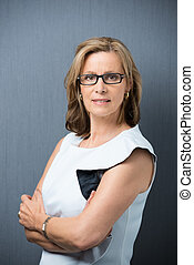 Serious confident middle-aged woman