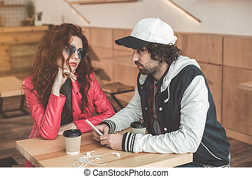 Serious couple having date in cafe