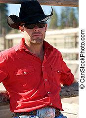 Serious Cowboy - serious looking cowboy sitting at the ...