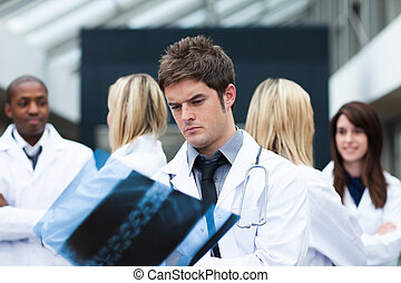 Serious doctor examining an x-ray
