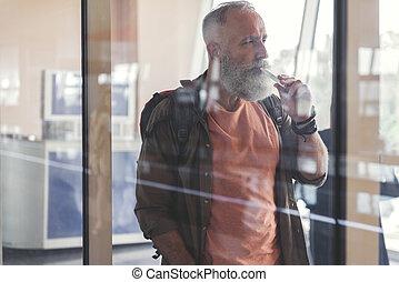Serious elder man in waiting hall
