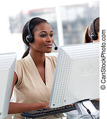 Serious ethnic businesswoman working in a call center