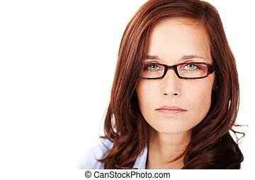 Serious face - Brunette woman with glasses in a serious look...