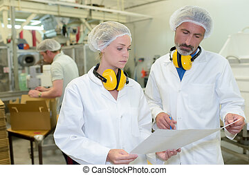 serious factory workers