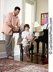 Serious father talking to teenage son at home - Serious...