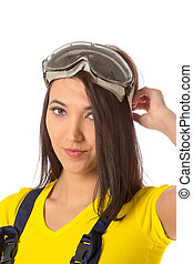 Serious female construction worker with goggles