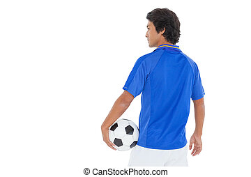 Serious football player over white background