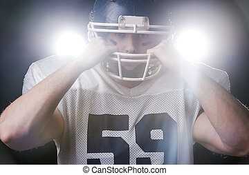 Serious game is beginning.  Portrait of American football player