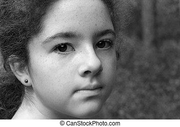 Serious Girl B&W - A teenaged girl, staring toward the...