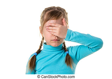 Serious girl closes eyes with her left hand, isolated on the white background