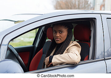 Serious girl in a car, African American
