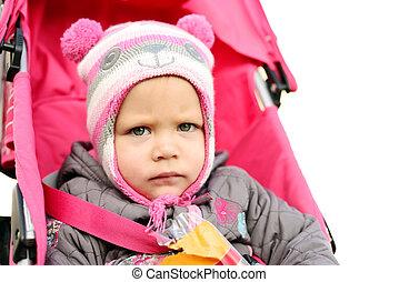 serious girl in stroller