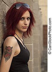 serious girl standing near a wall - serious deviant girl ...
