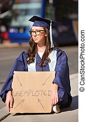 Serious Graduate with Unemployed Sign - Female graduate with...