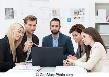 Serious group of business people in a meeting