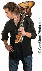 Serious Guitarist Looks Down