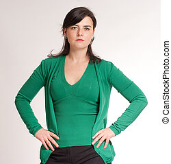 Serious Hands on hips brunette - Portrait of an attractive...