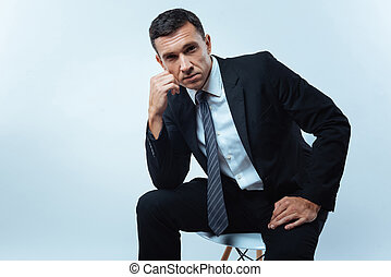 Serious handsome entrepreneur looking at you