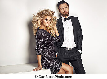 Serious handsome man with his blond lovely wife