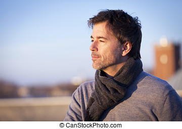 Serious Handsome Mature Man Dreaming outside On a Roof....
