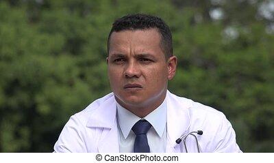Serious Hispanic Male Doctor