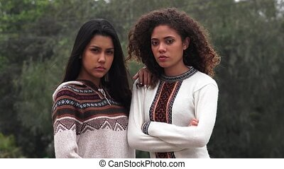 Serious Hispanic Teen Girls