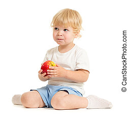 serious kid eating healthy food isolated