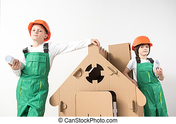 Serious kids learning to build a house