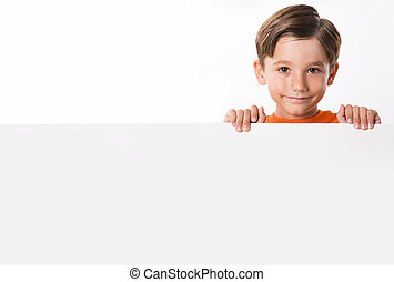 Photo of youngster behind white partition holding it by hands