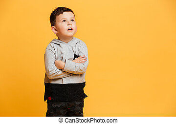 Serious little boy child standing isolated