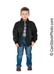 Serious little boy in a jacket