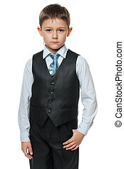 Serious little boy in suit