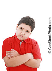 serious little boy with hands folded standing isolated on white background
